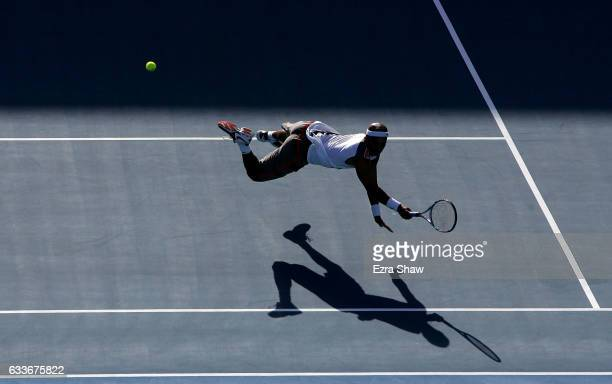 James Blake of the United States dives for the ball during his match against Fabrice Santoro of France during day two of the Medibank International...