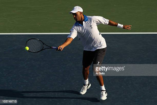 James Blake of the United States returns a shot against Kristof Vliegen of Belgium during his first round men's single's match on day two of the 2010...