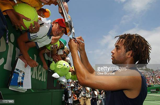 James Blake of the USA signs autographs after his match with Jose Acasuso of Argentina during the Australian Open Tennis Championships at Melbourne...