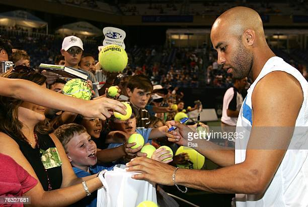 James Blake of the USA signs autographs after the Pilot Pen Tennis Tournament Singles Championship match at the Connecticut Tennis Center at Yale...