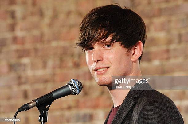 James Blake poses in front of the winners boards during the Barclaycard Mercury Prize 2013 at The Roundhouse on October 30 2013 in London England