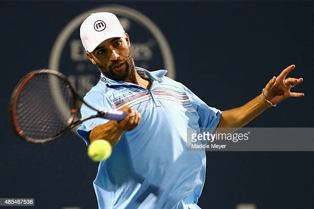 James Blake returns a forehand to Andy Roddick during their match as part of the Men's Legends presented by PowerShares Series on Day 4 of the...