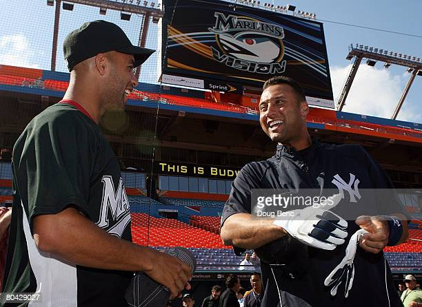 James Blake talks with Derek Jeter of the New York Yankees before a game against the Florida Marlins at Dolphin Stadium on March 29 2008 in Miami...