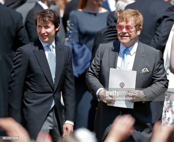 James Blunt and Elton John attend the wedding of Prince Harry to Ms Meghan Markle at St George's Chapel Windsor Castle on May 19 2018 in Windsor...