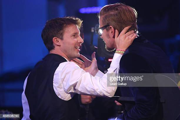 James Blunt and Joko Winterscheidt are seen on stage at the GQ Men Of The Year Award 2014 at Komische Oper on November 6 2014 in Berlin Germany