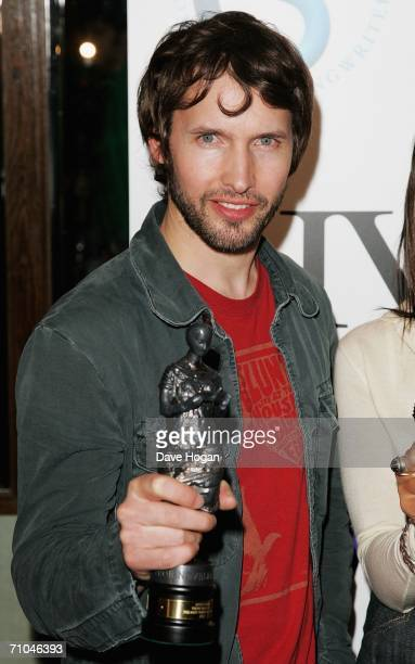 James Blunt poses with his award for the PRs Most Performed Work category at the 51st Ivor Novello Awards at the Grosvenor House Hotel on May 25 2006...