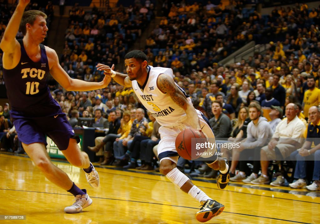 James Bolden #3 of the West Virginia Mountaineers drives against Vladimir Brodziansky #10 of the TCU Horned Frogs at the WVU Coliseum on February 12, 2018 in Morgantown, West Virginia.