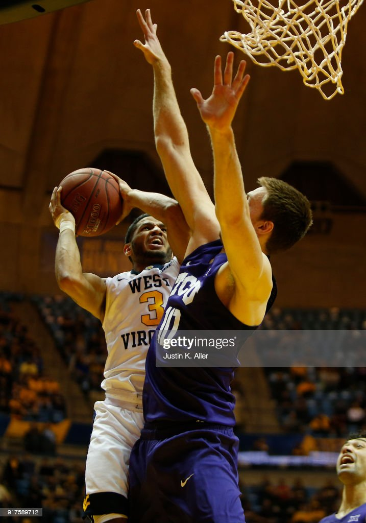James Bolden #3 of the West Virginia Mountaineers drives to the rim against Vladimir Brodziansky #10 of the TCU Horned Frogs at the WVU Coliseum on February 12, 2018 in Morgantown, West Virginia.