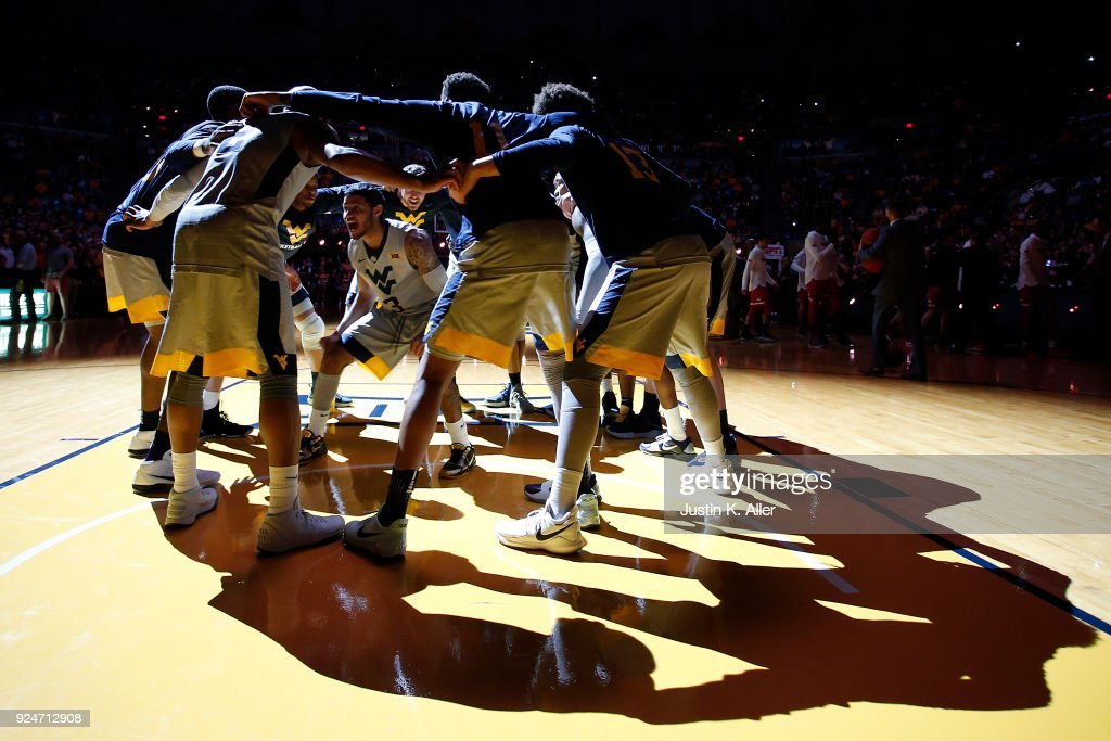 James Bolden #3 of the West Virginia Mountaineers huddles with his teammates before the game against the Texas Tech Red Raiders at the WVU Coliseum on February 26, 2018 in Morgantown, West Virginia.