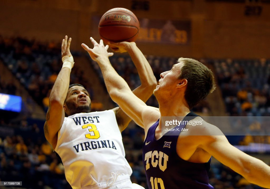 James Bolden #3 of the West Virginia Mountaineers pulls up for a shot against Vladimir Brodziansky #10 of the TCU Horned Frogs at the WVU Coliseum on February 12, 2018 in Morgantown, West Virginia.
