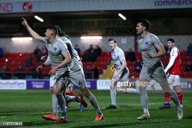 James Bolton of Portsmouth FC celebrates scoring his sides first goal during the FA Cup Third Round match between Fleetwood Town and Portsmouth FC at...