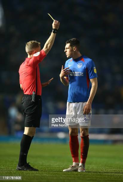 James Bolton of Portsmouth is shown a yellow card by referee Will Finnie during the Leasingcom Trophy match between Portsmouth and Northampton Town...
