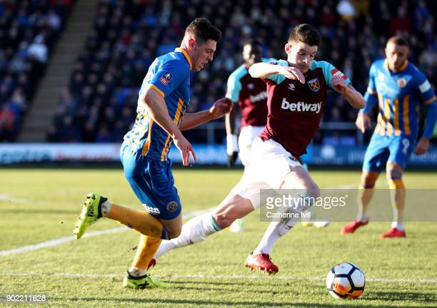 James Bolton of Shrewsbury Town and Declan Rice of West Ham United battle for possession during The Emirates FA Cup Third Round match between...