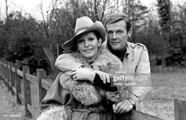 James Bond actor Roger Moore and his actress wife Luisa Mattioli relax outside their home In January 1973 in Denham England