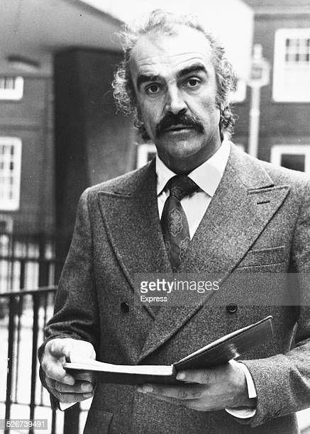 'James Bond' actor Sean Connery greeting reporters outside a London Divorce Court October 5th 1973