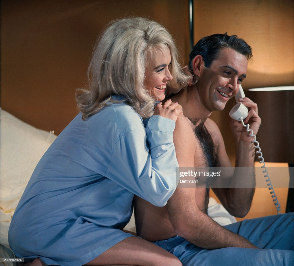 James Bond (Sean Connery) and Jill Masterson (Shirley Eaton) share a laugh on the phone in the James Bond flick, Goldfinger. 1964.