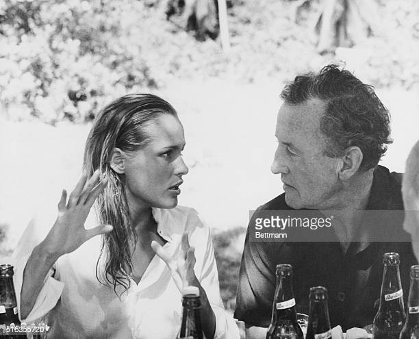 James Bond creator Ian Fleming chats with actress Ursula Andress between scenes of the upcoming action spy film Dr No The Swiss actress is appearing...