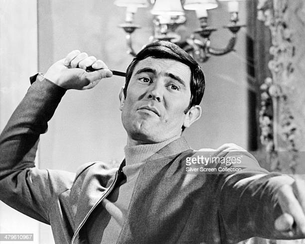 James Bond played by Australian actor George Lazenby throws a knife in a scene from 'On Her Majesty's Secret Service' directed by Peter R Hunt 1969