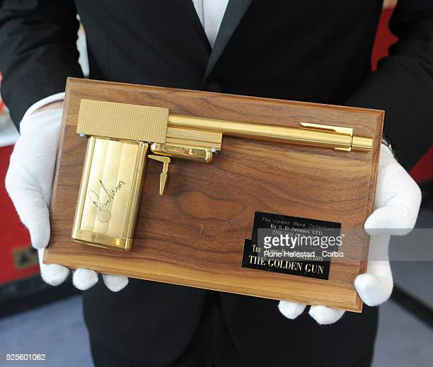 A James Bond replica gun from The Man With The Golden Gun is displayed as part of Bonhams Entertainment Memorabilia auction at Bonhams Knightsbridge