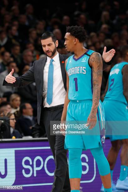 James Borrego and Malik Monk of the Charlotte Hornets talk during the game against the Milwaukee Bucks as part of NBA Paris Games 2020 on January 24,...