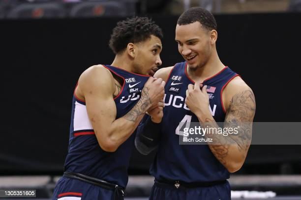 James Bouknight and Tyrese Martin of the Connecticut Huskies in action against the Seton Hall Pirates during an NCAA college basketball game at...