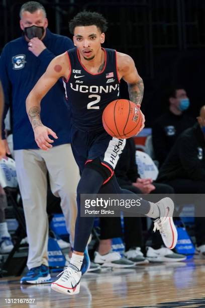 James Bouknight of the Connecticut Huskies dribbles the ball against the Creighton Bluejays during a Big East Tournament semifinal game at Madison...