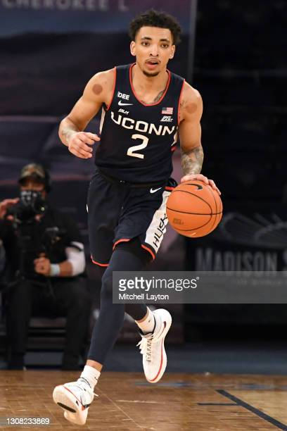 James Bouknight of the Connecticut Huskies dribbles up court during the Big East Men's Basketball Tournament - Semifinals college basketball game...