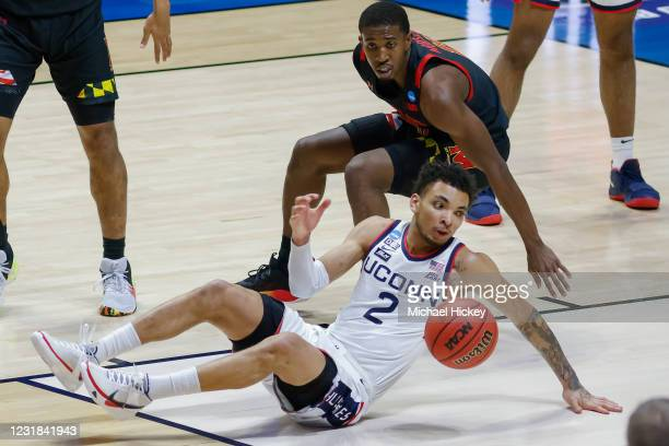 James Bouknight of the Connecticut Huskies falls while driving thru the lane as Darryl Morsell of the Maryland Terrapins defends during the second...