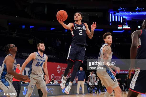 James Bouknight of the Connecticut Huskies goes in for a layup against the Creighton Bluejays during a Big East Tournament semifinal game at Madison...