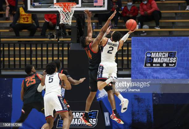 James Bouknight of the Connecticut Huskies looks to shoot against Donta Scott of the Maryland Terrapins during the first half in the first round game...