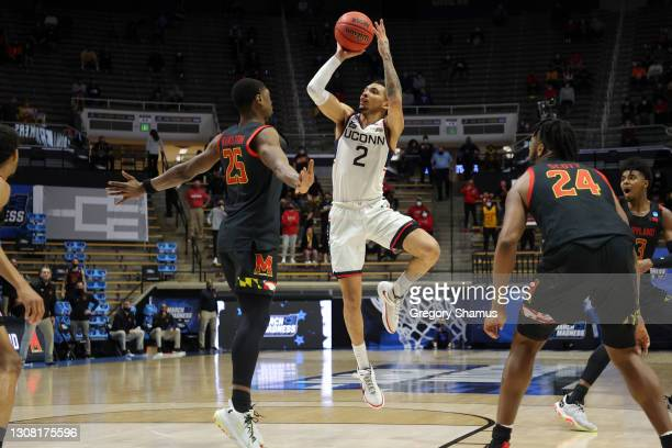 James Bouknight of the Connecticut Huskies shoots against Jairus Hamilton of the Maryland Terrapins during the second half in the first round game of...