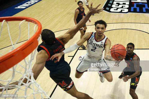 James Bouknight of the Connecticut Huskies shoots against the Maryland Terrapins during the first half in the first round game of the 2021 NCAA Men's...