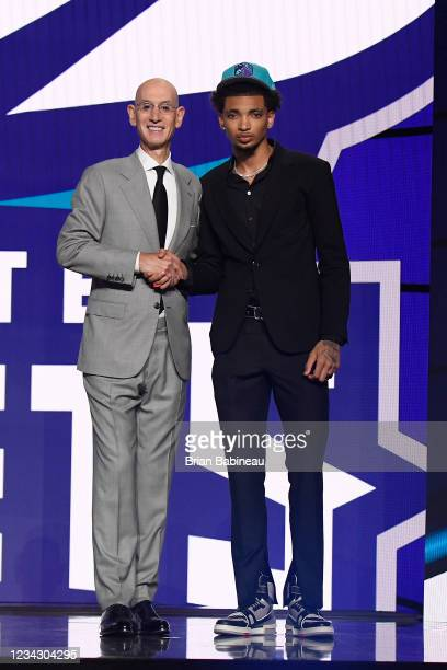 James Bouknight shakes hands with NBA Commissioner Adam Silver after being selected number eleven overall by the Charlotte Hornets during the 2021...