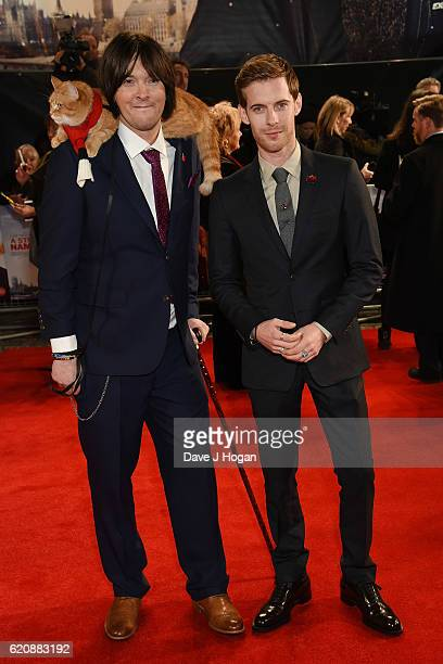 James Bowen with Bob the cat and Luke Treadway attend the UK Premiere of A Street Cat Named Bob in aid of Action On Addiction on November 3 2016 in...