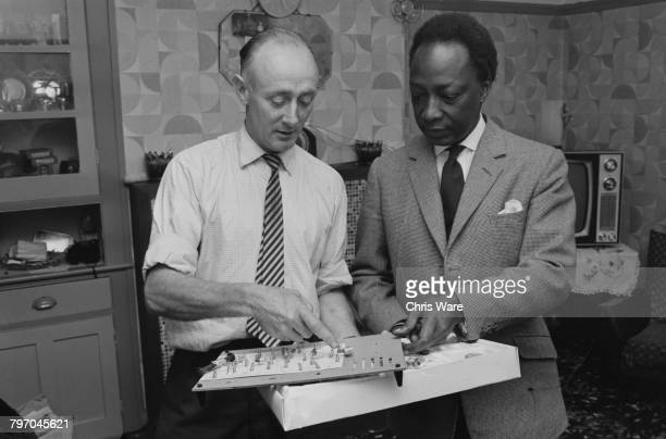James Bowtell showing his homemade radio set to Mutesa II of Buganda at his home in Bermondsey London July 1968 Mutesa II Kabaka of Buganda and...