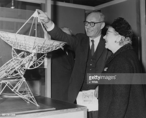 James Boyden Joint Parliamentary Secretary of State at the Department of Education and Science examines a model of a new radio telescope built by the...