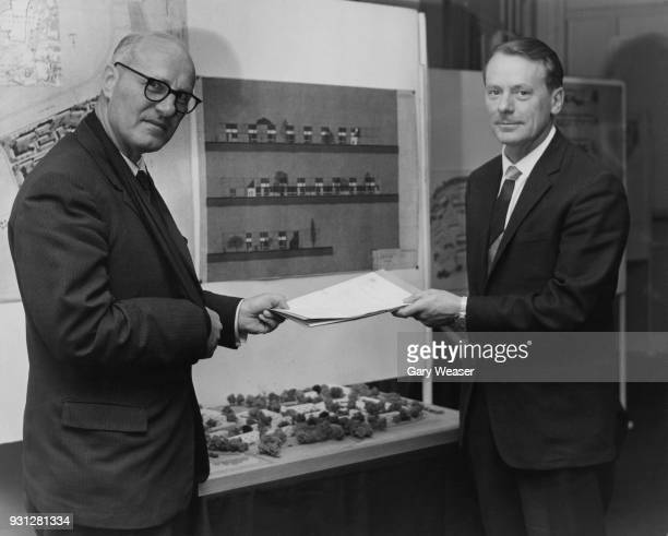 James Boyden Parliamentary Secretary to the Ministry of Public Building and Works accepts a tender from Sir Maurice Laing chairman of building...