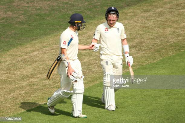 James Bracey and Dom Bess of the England Lions leave of the field of play before break during the Four Day match between Australia A and the England...