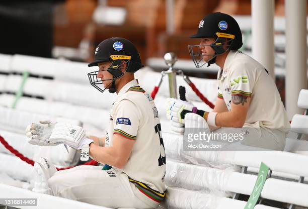 James Bracey and Ryan Higgins of Gloucestershire wait to go out to bat after tea on Day Two of the LV= Insurance County Championship match between...
