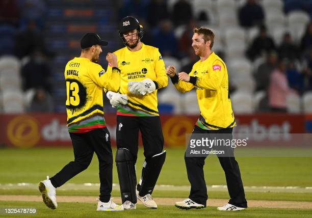 James Bracey , Benny Howell and Tom Smith of Gloucestershire celebrate the wicket of Will Beer of Sussex during the Vitality T20 Blast match between...