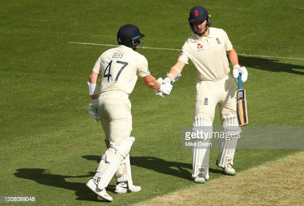 James Bracey is congratulated by Dom Bess of the England Lions after scoring 50 runs during the Four Day match between Australia A and the England...