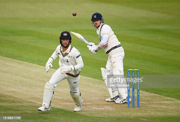 James Bracey of Gloucestershire makes chase after a shot from Sam Robson of Middlesex during Day Two of the LV= Insurance County Championship match...