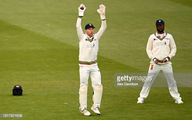 James Bracey of Gloucestershire reacts watched on Kraigg Brathwaite during Day Two of the LV= Insurance County Championship match between Middlesex...