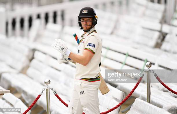 James Bracey of Gloucestershire walks out to bat after tea on Day Two of the LV= Insurance County Championship match between Middlesex and...
