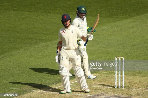 James Bracey of the England Lions raises his bat after scoring 50 runs during the Four Day match between Australia A and the England Lions at...