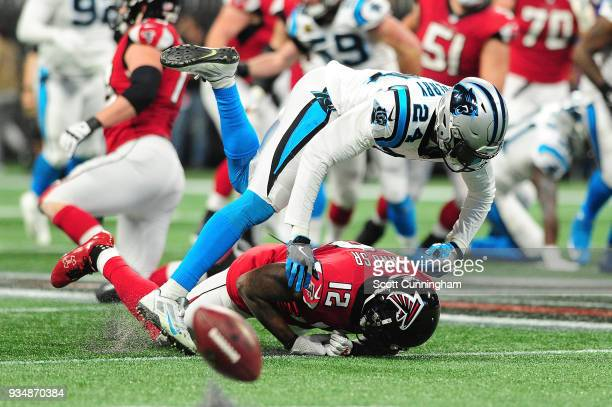 James Bradberry of the Carolina Panthers breaks up a pass intended for Mohamed Sanu of the Atlanta Falcons during the first half at MercedesBenz...