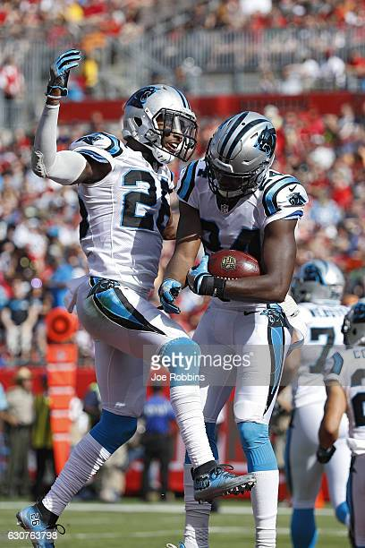 James Bradberry of the Carolina Panthers celebrates with Daryl Worley after an interception against the Tampa Bay Buccaneers in the first quarter of...