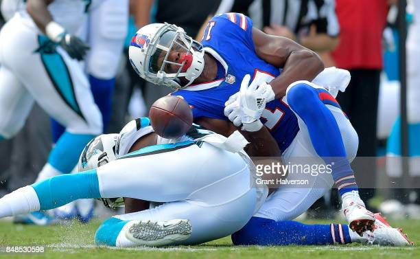 James Bradberry of the Carolina Panthers separates Zay Jones of the Buffalo Bills from the ball during their game at Bank of America Stadium on...