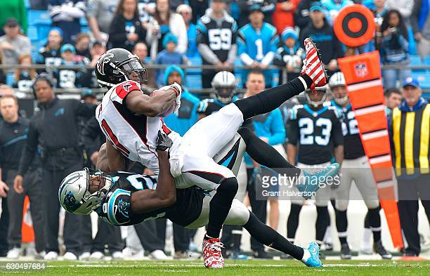 James Bradberry of the Carolina Panthers tackles Julio Jones of the Atlanta Falcons in the 1st quarter during the game at Bank of America Stadium on...
