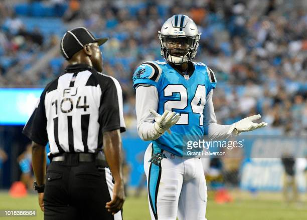 James Bradberry of the Carolina Panthers talks with a referee between plays against the Miami Dolphins during the game at Bank of America Stadium on...
